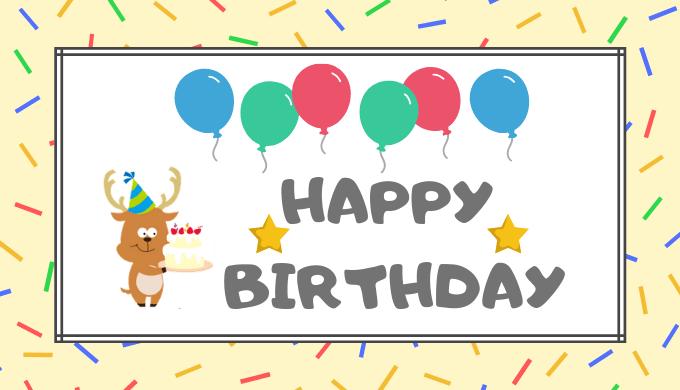 誕生日ケーキを持った鹿のマスコットキャラ